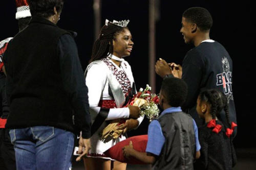 Ayo Abiara, 12, smiles as she gets crowned as Legacy's 2018 Homecoming Queen. Legacy beat Bryan Adams, 55-12. (Ellie Brutsché photo)