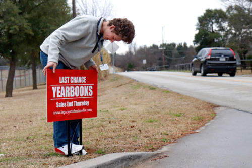 Grant Gourley,12, stakes a sign reminding students to purchase their yearbooks on Jan. 11. Yearbooks must be bought before Thursday, Jan. 17. Ask a friend in journalism for a special code to receive $10 off. (Seth Miller Photo)