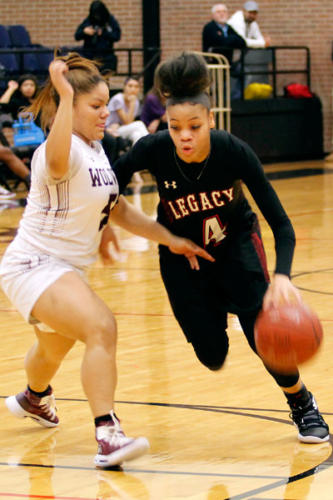 Harmoni Turner, 11, dribbles the ball down the court past the opposing team during the varsity girls basketball game. Legacy lost  against Timberview High School, 85-47. (Madison Gonzales photo)
