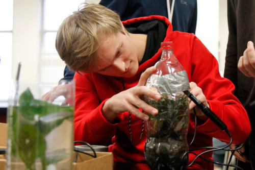 Landon Wentz, 12, tests the humidity and temperature of his terrestrial ecobottle during APES. Students in Ms. Michelle Fagan's AP Environmental Science class construct terrestrial and aquatic ecobottles and observe the different changes in data over time. (Ellie Brutsché photo)
