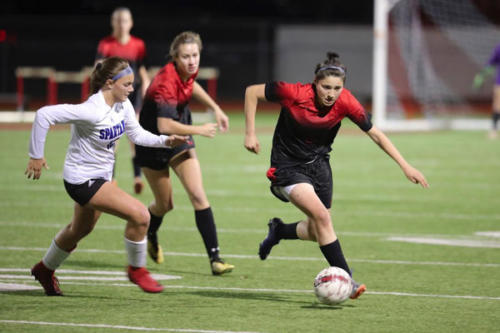 Lilee Simpson, 11, dribbles the ball down the field during the varsity girls soccer game. Legacy loses after three rounds of penalty kicks to Centennial High School, 8-7. (Seth Miller photo)