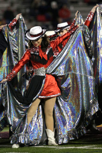 """Kassandra Saenz, 12, performs the skirt routine to """"Despacito"""" with drill team during halftime at the varsity football game on Nov. 9. Varsity football won the game against Dallas Sunset, 56-0, and advanced to the first round of playoffs. (Ellie Brutsché photo)"""