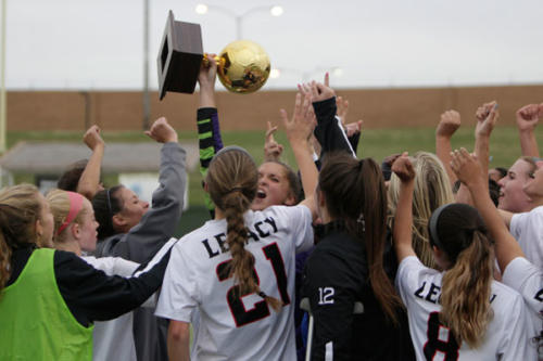 Tatum Krueger, 12, celebrates with her team after the varsity soccer girls win against Aledo on April 12. The varsity soccer team will play against Highland Park on  April 20 in the state tournament. (Ellie Brutsché photo)