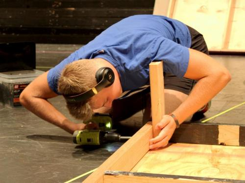 """In Technical Theater, Cade Gordon, 11, drills pieces of a set together for the fall show. Theatre's fall show """"The Servant of Two Masters"""" is Oct. 14-17 at the Legacy PAC. (Catherine Walworth Photo)"""