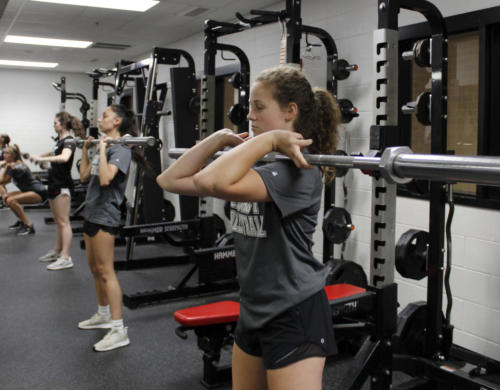 Payton Hyden,10,works out in the weight room during 4th period volleyball.Tryouts begin August 1.(Madison Gonzales photo)