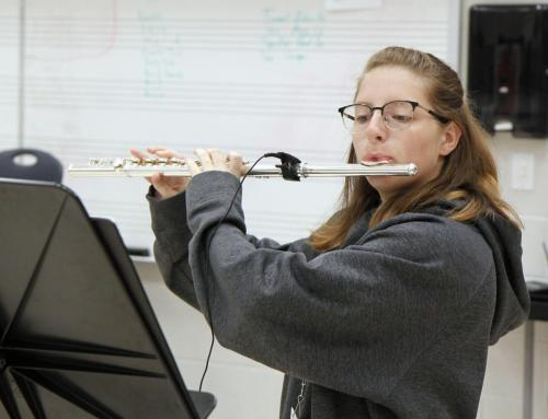 In the band hall during first period, Sam Smith, 9, plays her flute in warm-up tuning, before they start to practice for their Homecoming performance. The band will perform at 6 p.m. before the homecoming game Sept. 10 at Newsom Stadium. (Matthew Carroll Photo)
